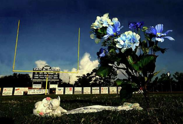 A memorial marks the spot where quarterback, Reggie Garrett threw his last touchdown pass at West Orange-Stark High School in West Orange. Tammy McKinley/The Enterprise Photo: TAMMY MCKINLEY / Beaumont