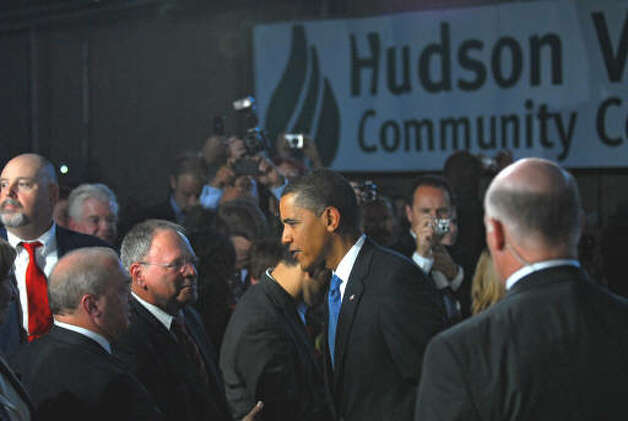 President Barack Obama greets members of the audience after finishing his speech at Hudson Valley Community College in Troy. (Philip Kamrass / Times Union)
