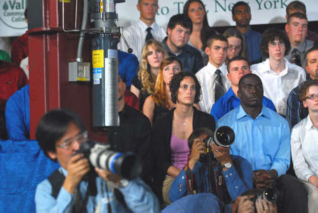 HVCC students listen as photographers from the national media take pictures of President Barack Obama speech at Hudson Valley Community College in Troy.  (Philip Kamrass / Times Union)