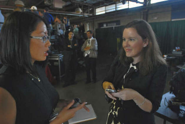 White House staffer Moira Mack, right, originally from Albany, talks to a reporter before President Barack Obama's speech at Hudson Valley Community College in Troy.  (Philip Kamrass / Times Union)