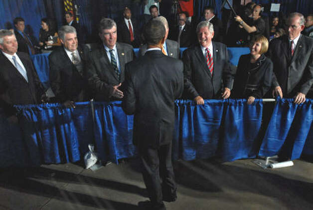 President Obama, back to camera, greets Capital Region politicians following his speech at Hudson Valley Community College in Troy on Monday, Sept. 21, 2009. From left to right are Assemblymen Kevin Cahill (Ulster County), John McEneny,  State Senators Neil Breslin and Roy McDonald,  Rensselaer County Executive Kathy Jimino, and Albany County Executive Michael Breslin. Obscured behind the President is Schenectady Mayor Brian Stratton. (Philip Kamrass / Times Union)