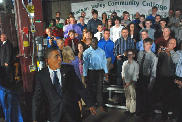President Obama starts to walk away after shaking hands with HVCC students before returning to pose for a group photograph following his speech at Hudson Valley Community College in Troy on Monday, Sept. 21, 2009.  (Philip Kamrass / Times Union)