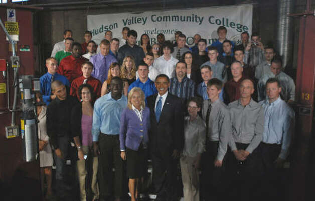 President Obama and Dr. Jill Biden, wife of Vice President Joseph Biden, left, pose for a group photograph with HVCC students following his speech at Hudson Valley Community College in Troy.  (Philip Kamrass / Times Union)
