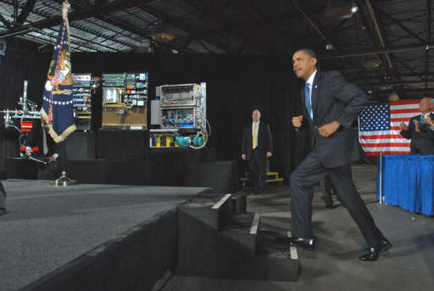 President Obama ascends the stage to make his speech at Hudson Valley Community College in Troy  on Sept. 21, 2009.  (Philip Kamrass / Times Union)