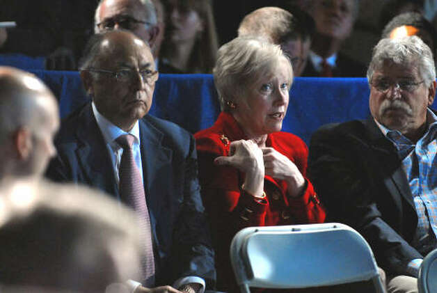 Hector Ruiz, chairman of the board of GlobalFoundries, left, and Nancy Zimpher, SUNY Chancellor, right, talk  before President Obama's speech at Hudson Valley Community College in Troy on Monday, Sept. 21, 2009.  (Philip Kamrass / Times Union)