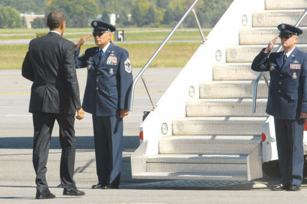 Crew members at the foot of the steps of Air Force One salute the President at the Albany International Airport on Monday, Sept 21, 2009, in Albany.  (Luanne M. Ferris / Times Union)