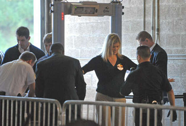 People go through the metal detector before President Obama makes a speech about the economy and community colleges at Hudson Valley Community College in Troy on Sept. 21, 2009.  (Lori Van Buren / Times Union)