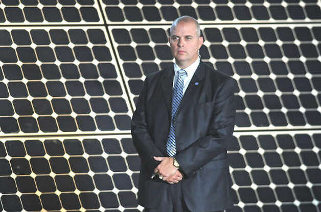 A secret service man stands in front of solar panels on the side of the stage before President Obama makes a speech about the economy and community colleges at Hudson Valley Community College in Troy on Sept. 21, 2009.  (Lori Van Buren / Times Union)