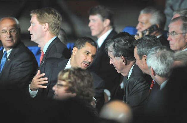 Gov. David Paterson talks to Sen. Neil Breslin while waiting to hear President Obama makes a speech about the economy and community colleges at Hudson Valley Community College in Troy on Sept. 21, 2009.  (Lori Van Buren / Times Union)