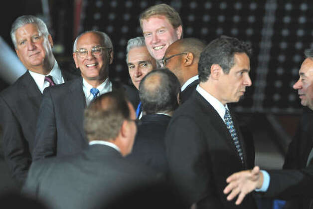 State and local politicians including Albany Mayor Jerry Jennings, Congressman Paul Tonko, U.S. Rep. Scott Murphy and Andrew Cuomo mingle as they wait for President Barack Obama to make a speech about the economy and community colleges at Hudson Valley Community College in Troy on Sept. 21, 2009.  (Lori Van Buren / Times Union)