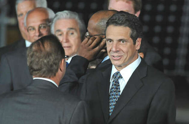 Attorney General Andrew Cuomo waits with other state and local officials for President Obama to make a speech about the economy and community colleges at Hudson Valley Community College in Troy on Sept. 21, 2009.  (Lori Van Buren / Times Union)