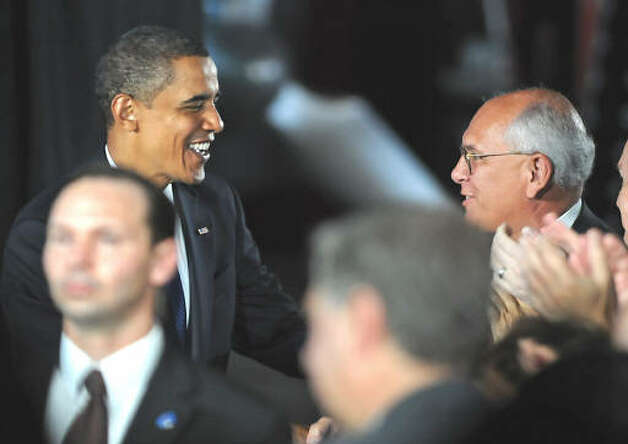 President Barack Obama greets Congressman Paul Tonko on his way to make a speech about the economy and community colleges at Hudson Valley Community College in Troy on Sept. 21, 2009.  (Lori Van Buren / Times Union)