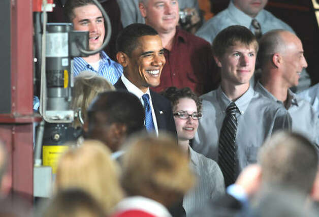 President Barack Obama poses for photos with students after making a speech about the economy and community colleges at Hudson Valley Community College in Troy on Sept. 21, 2009.  (Lori Van Buren / Times Union)