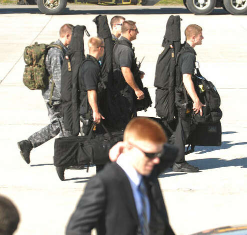 Security personal get into position before the arrival of Air Force One at Albany International Airport Monday morning. President Obama visited the Capital Region to deliver an address on education and the economy at Hudson Valley Community College.  (Luanne M. Ferris / Times Union)