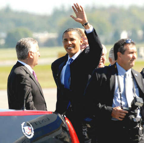 President Barack Obama waves at some bystanders after landing at Albany International Airport  Monday moring. President Obama visited the Capital Region to deliver an address on education and the economy at Hudson Valley Community College.  (Luanne M. Ferris / Times Union)