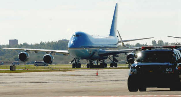 Air Force One lands and taxis at Albany International Airport. President Obama visited the Capital Region to deliver an address on education and the economy at Hudson Valley Community College.  (Luanne M. Ferris / Times Union)