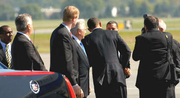 President Obama greets Gov. David Paterson after the president emerged from Air Force One, at the Albany International Airport on Monday, Sept 21, 2009.  (Luanne M. Ferris / Times Union)