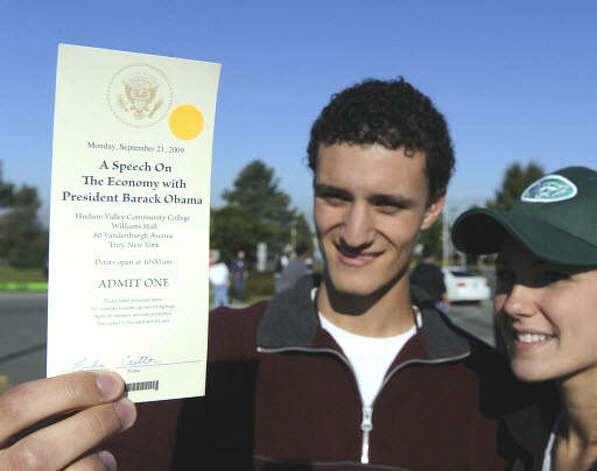 Luke Cutler, of Clifton Park, left,  was one of the lucky students to receive a ticket for today's visit by  President Barak Obama to Hudson Valley Community College in Troy. Erika Frodey, right, of Clifton Park, was not on the ticket list and had to leave her friend at the entry point. ( Skip Dickstein / Times Union)