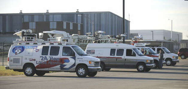 Television crews are in place to capture the arrival of President Obama. who is flying into Albany International Airport before heading to Hudson Valley Community College for a speech on education and the economy. (Skip Dickstein / Times Union)