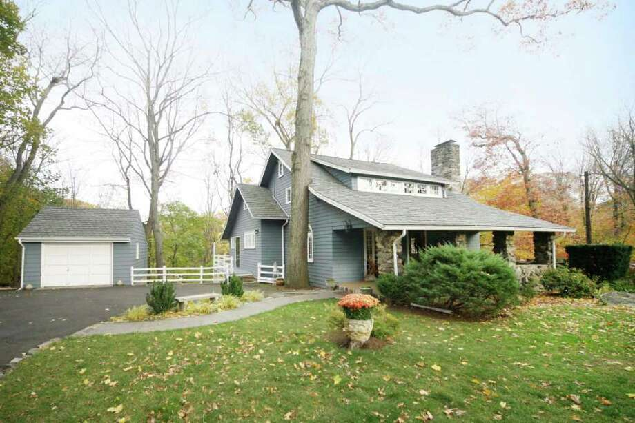 Originally part of the Delafield estate in Darien, Cedar Gate, established in 1910, has 40 rolling wooded acres and winding roads, and by 1935 had some 25 homes in a wide variety of styles. Photo: File Photo / Stamford Advocate File Photo