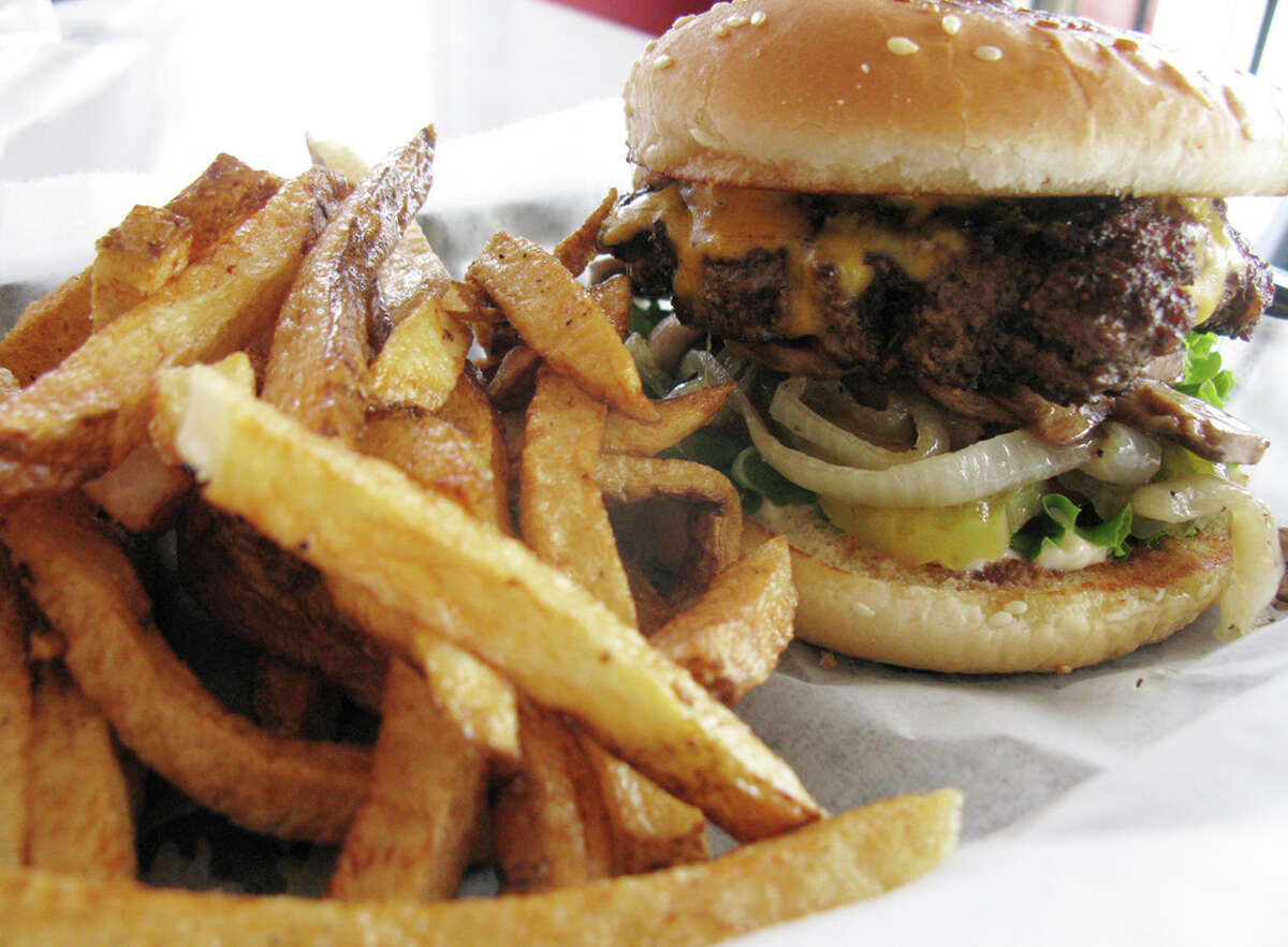 The Fattboy with cheese comes with a choice of toppings and is served with a side of Slimm Fries which are fried in peanut oil. JENNIFER McINNIS / EXPRESS-NEWS