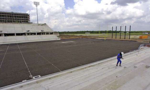 "The new Dr.Carrol A. ""Butch"" Thomas Educational Support Center football stadium is on schedule, but possible problems have developed with a least a dozen spots below ground rising up several inches and causing an un-level playing surface.  Soil tests are being done with results expected back soon.     Dave Ryan/The Enterprise Photo: Dave Ryan / Beaumont"