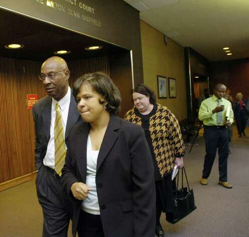 BISD Superintendent Carrol Thomas, left, and BISD attorney Melody Chappell, leave Judge Donald Floyd's 172nd District Court after the judge recessed the court.   Floyd is hearing an injunction case filed against BISD by the BETTER group.  Michael Getz is the attorney for the BETTER group. Dave Ryan/The Enterprise / Beaumont