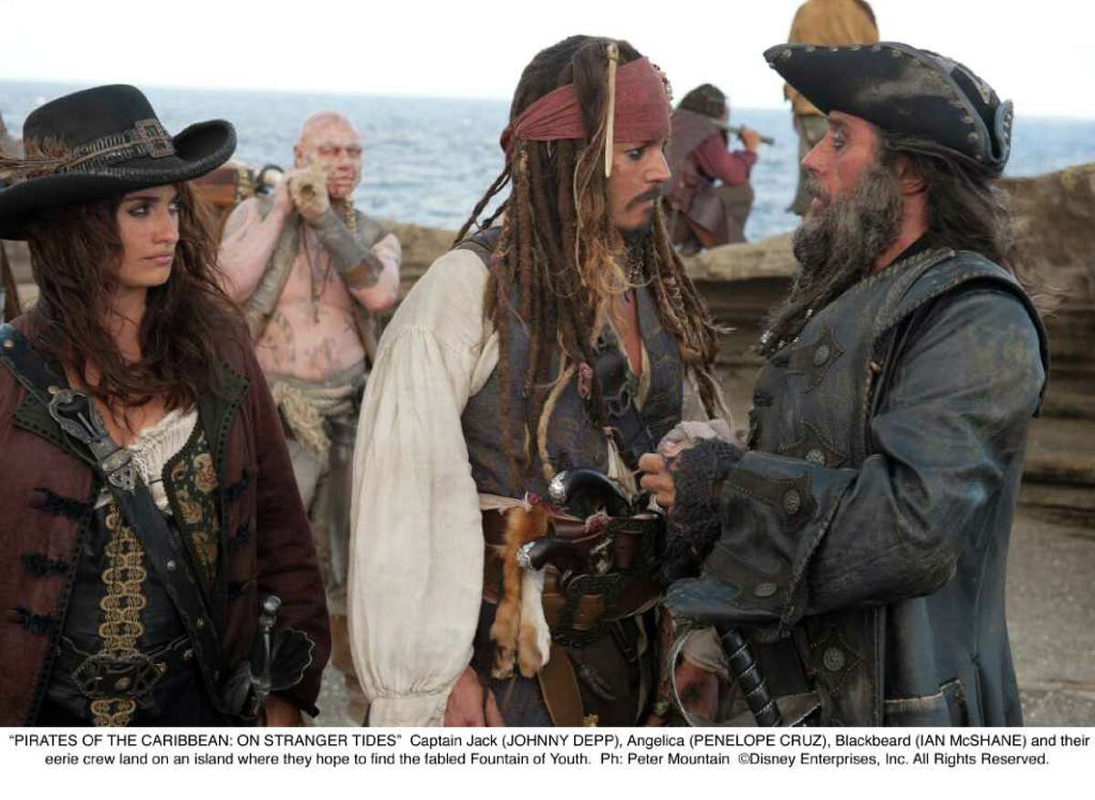 """""""PIRATES OF THE CARIBBEAN: ON STRANGER TIDES"""": Captain Jack (JOHNNY DEPP), Angelica (PENELOPE CRUZ), Blackbeard (IAN McSHANE) and their eerie crew land on an island where they hope to find the fabled Fountain of Youth. (Peter Mountain/Disney Enterprises)"""