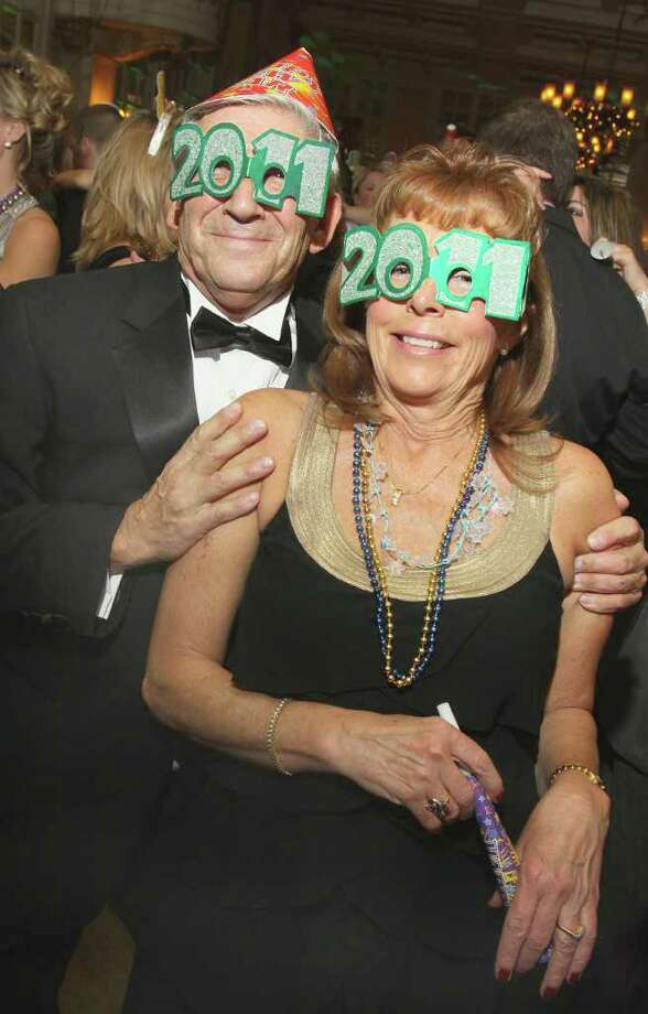 George Grannas and Cheryl Malone show off their festive eyewear. (Joe Putrock / Special to the Times Union) Photo: Joe Putrock / Joe Putrock