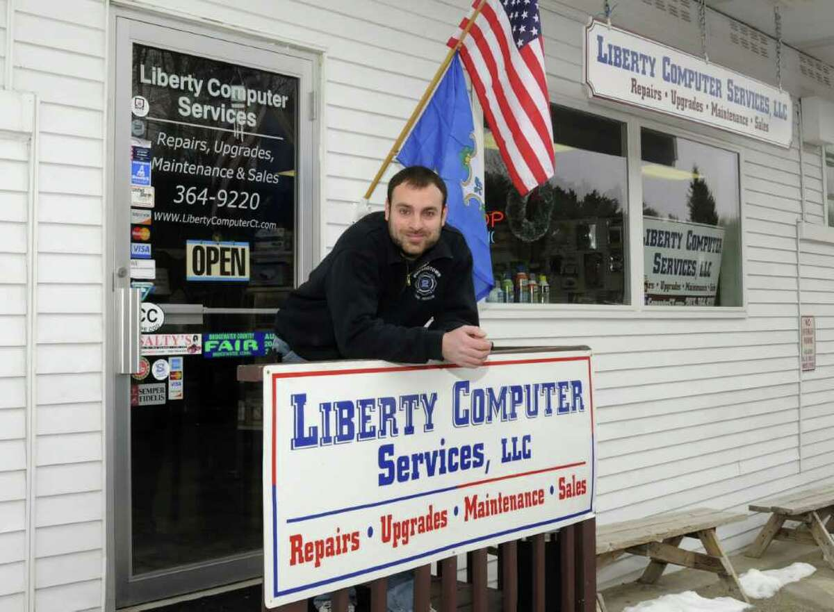 Liberty Computer Services owner Joe Masso stands at the entrance of his computer repair company, in Newtown, on Thursday, Jan. 6, 2011.