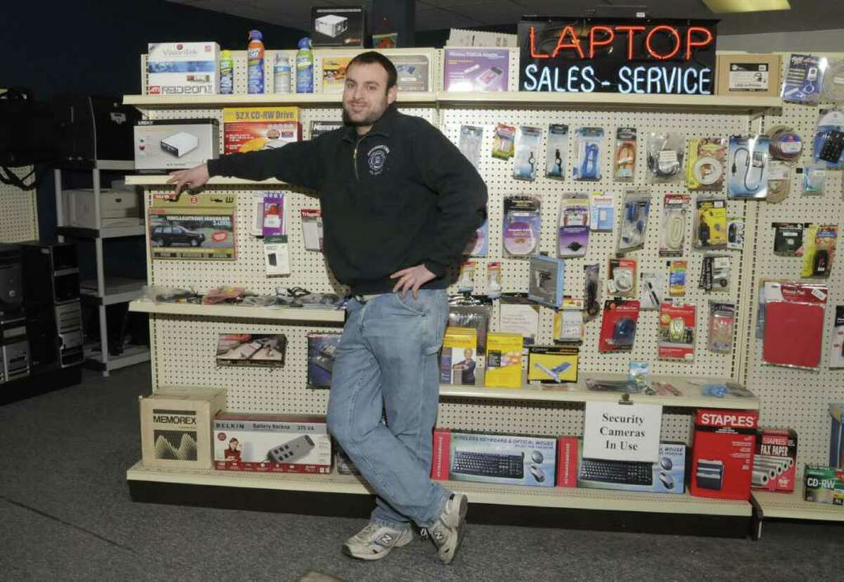 Joe Masso, owner of Liberty Computer Services in Newtown, at the accessories display in his showroom, on Thursday, Jan. 6, 2011.
