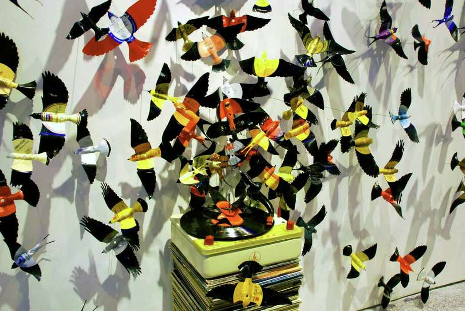 """""""Diaspora"""" by Paul Villinski, an installation made from vinyl LP records, record covers, a turntable and stainless steel wire will be featured in the """"Contemporary Souvenirs"""" exhibit at Sacred Heart University's Gallery of Contemporary Art. The exhibit in the Fairfield gallery opens Jan. 23. Photo: Contributed Photo / Fairfield Citizen contributed"""