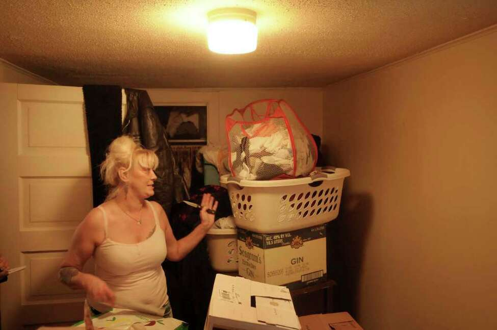 Rose Brundige stands in her former bedroom in her Watervliet apartment on Thursday, Jan. 6, 2011. Brundige has had to move her things out of the room's closet and away from the walls which she says are mold infested. (Paul Buckowski / Times Union)