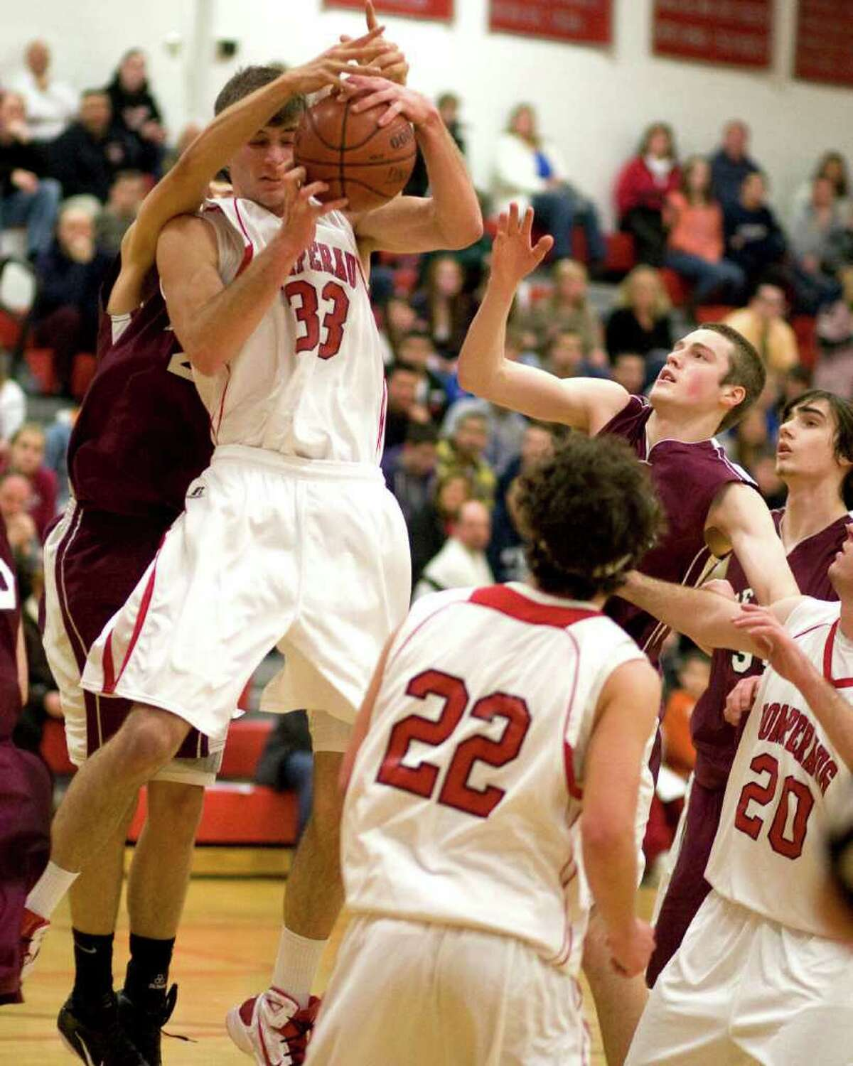 Pomperaug's 6-8 Andre Makris (33) is fouled from behind while grabbing a rebound against Bethel Thursday night at Pomperaug High.
