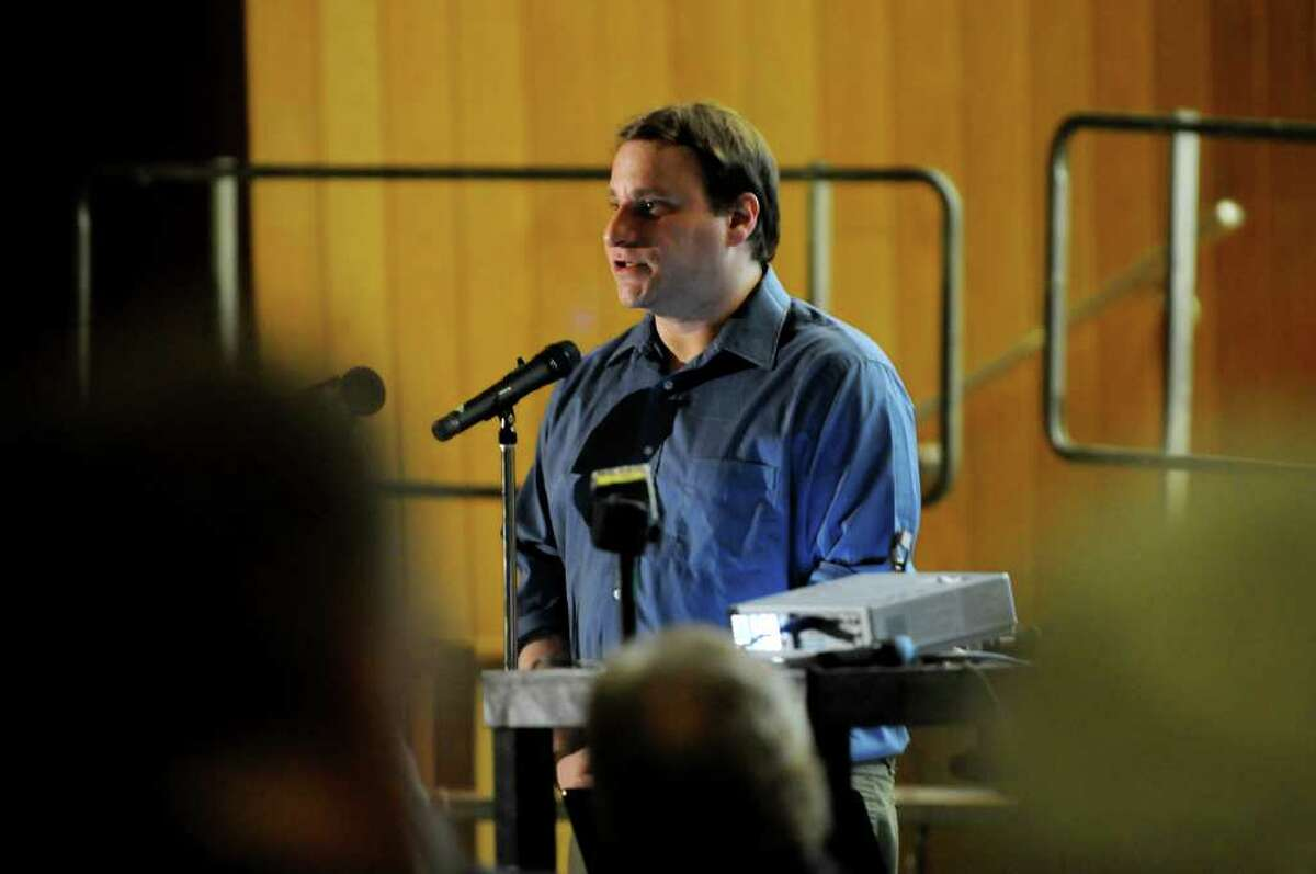 Harvard research fellow Michael Bank explains the results of a study on the presence of toxic heavy metals in 185 people who live in the vicinity of the Lafarge cement plant on Thursday at Ravena-Coeymans-Selkirk High in Ravena. (Cindy Schultz / Times Union)