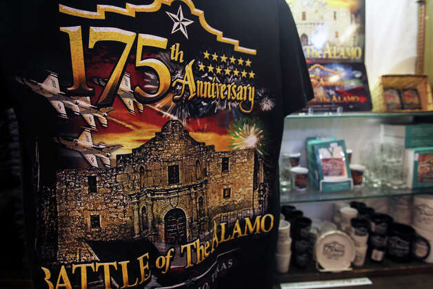 A tee shirt is among the items for sale on Jan. 6 at the Alamo gift shop commemorating the 175th anniversary of the Battle of the Alamo. Photo: Tom Reel, San Antonio Express-News / treel@express-news.net