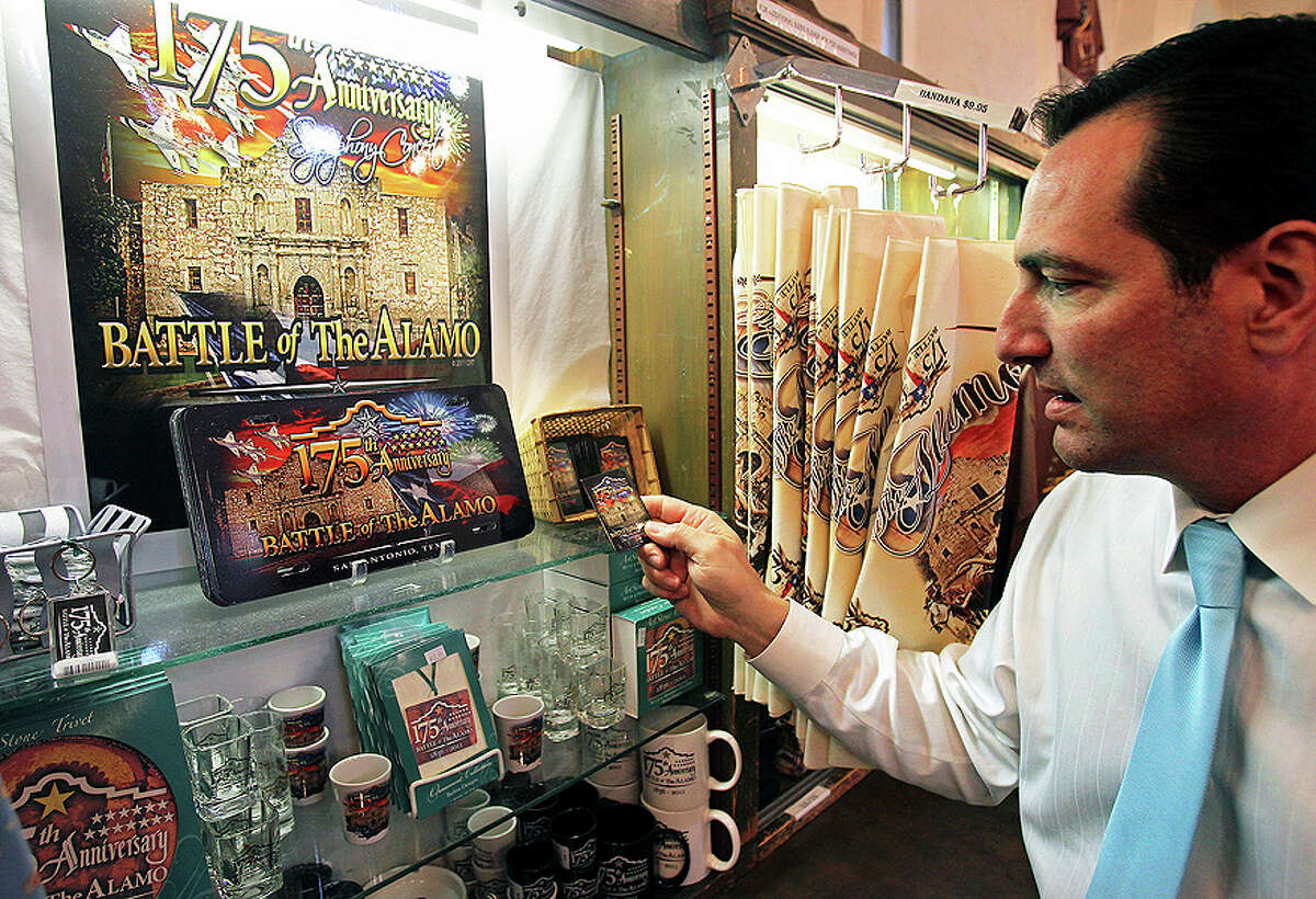 Alamo marketing director Tony Caridi looks through some of the items for sale commemorating the 175th anniversary of the Battle of the Alamo at the Alamo gift shop on Jan. 6.