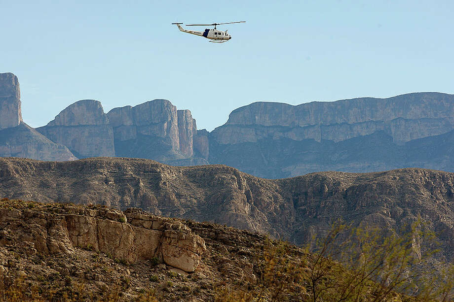 Customs and Border Protection Commissioner Alan Bersin flies over the international crossing at Boquillas in Big Bend National Park before a press conference on Jan. 6 where he announced that the crossing is scheduled to re-open in April 2012. Photo: Jerry Lara, San Antonio Express-News / glara@express-news.net