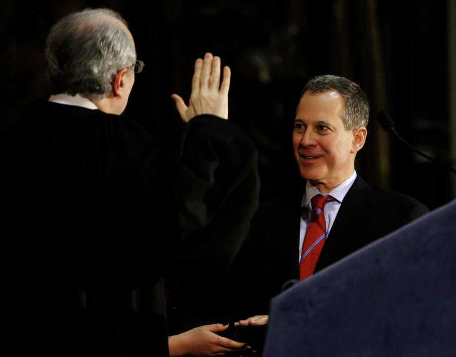 State Attorney General Eric  Schneiderman is targeting acid rain as his first lawsuit as attorney general. He appears at a swearing-in ceremony  at City College Thursday, Jan. 6, 2011  in New York. (AP Photo/Frank Franklin II) Photo: Frank Franklin II / AP