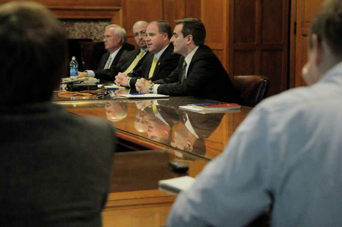 As a bloc of four of their Democratic colleagues have formed their own caucus, newly elected Senate Democrats Tony Avella, left, Gustavo Rivera, Tim Kennedy and Mike Gianaris hold an informal session with reporters Thursday at the Capitol. (Paul Buckowski / Times Union)
