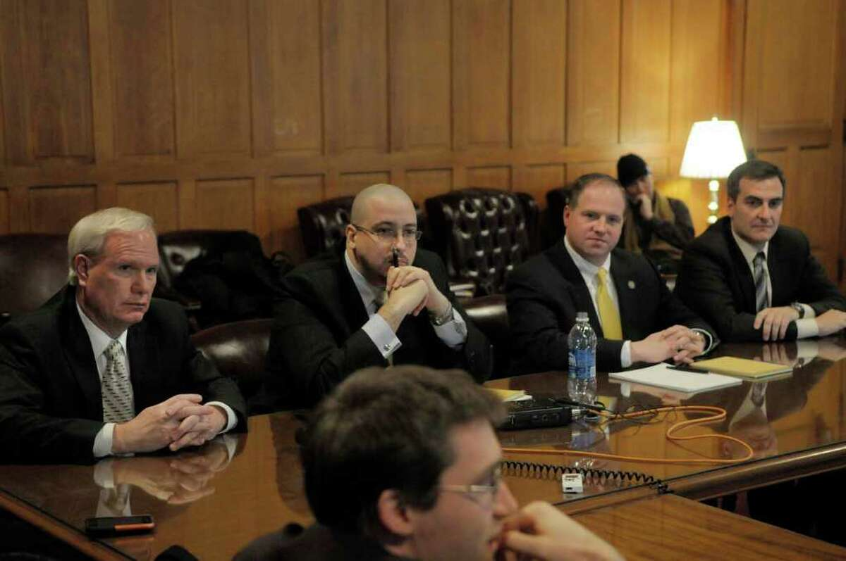 Newly elected Senate Democrats, Tony Avella, background left, Gustavo Rivera, background 2nd from left, Tim Kennedy, background 3rd from left, and Mike Gianaris, background right, talk with reporters during an informal meeting with members of the press in the Senate Minority conference room at the Capitol in Albany, NY on Thursday, Jan. 6, 2011. (Paul Buckowski / Times Union)
