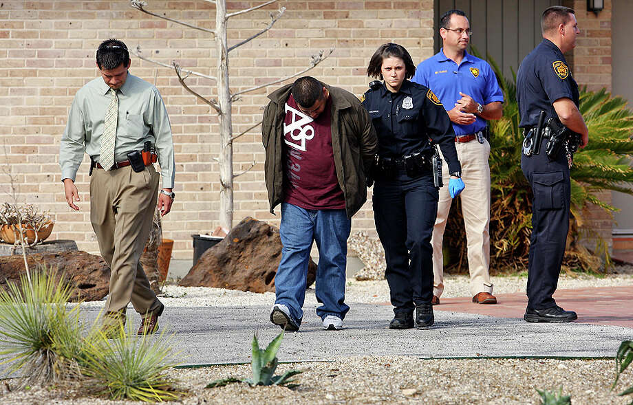 The second suspect in a home invasion and shooting in the 7100 block of Oakridge Drive is taken away from the scene after being identified by the homeowner  on Jan. 6.   The homeowner shot and killed the other suspect. Photo: Edward A. Ornelas / eaornelas@express-news.net