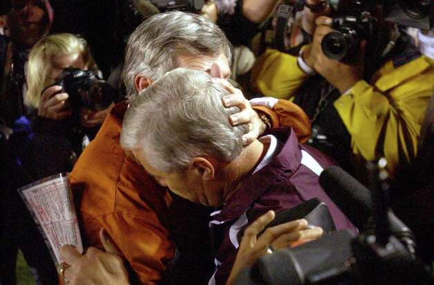 SPORTS - Texas head coach Mack Brown , left, embraces Texas A&M head coach Dennis Franchione after Texas defeated A&M in College Station on Friday, Nov. 28, 2003. BILLY CALZADA Photo: BILLY CALZADA, SAN ANTONIO EXPRESS-NEWS