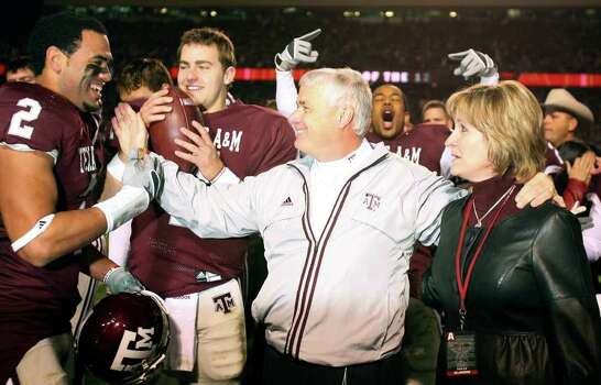 FOR SPORTS - Texas A&M's headcoach Dennis Franchione (center) and his wife Kim Franchione (right) celebrates with players Earvin Taylor (from left),  and Stephen McGee after the Aggies defeated the Texas Longhorns 38-30 Friday Nov. 23, 2007 at Kyle Field in College Station, Tx. Photo: EDWARD A. ORNELAS, SAN ANTONIO EXPRESS-NEWS / SAN ANTONIO EXPRESS-NEWS
