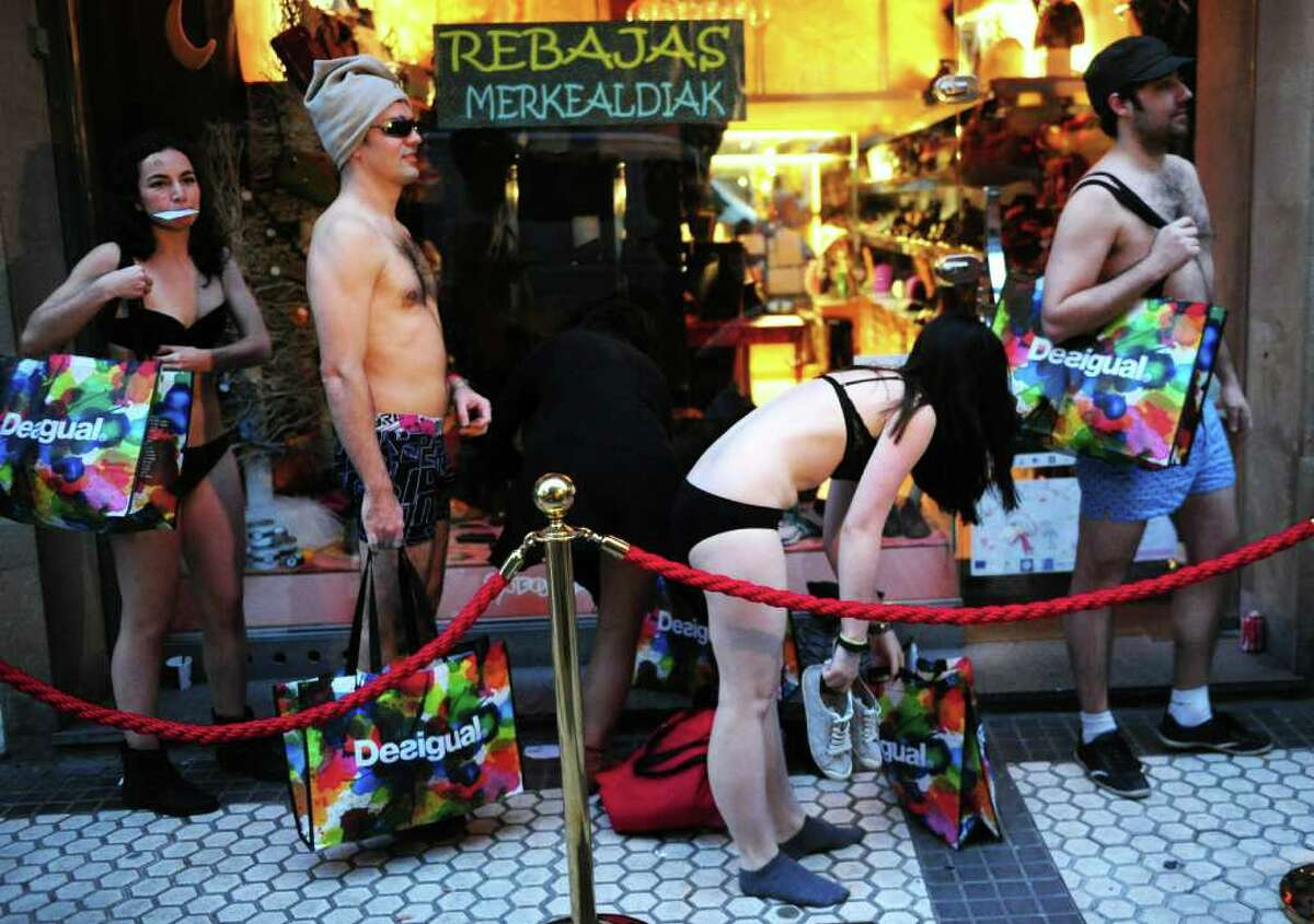 Customers wearing underwear queue outside a