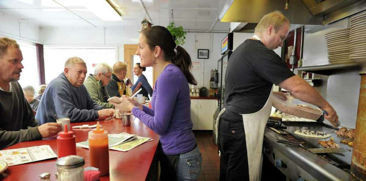 Waitress Kathleen Grove, left and owner Peter Homick, work the lunch time crowd at the Laurel Diner on South Main Street in Southbury. Laurel Diner, Southbury Bagel Delight, Newtown Bella's Cafe, New Haven Caffe Social, Norwalk