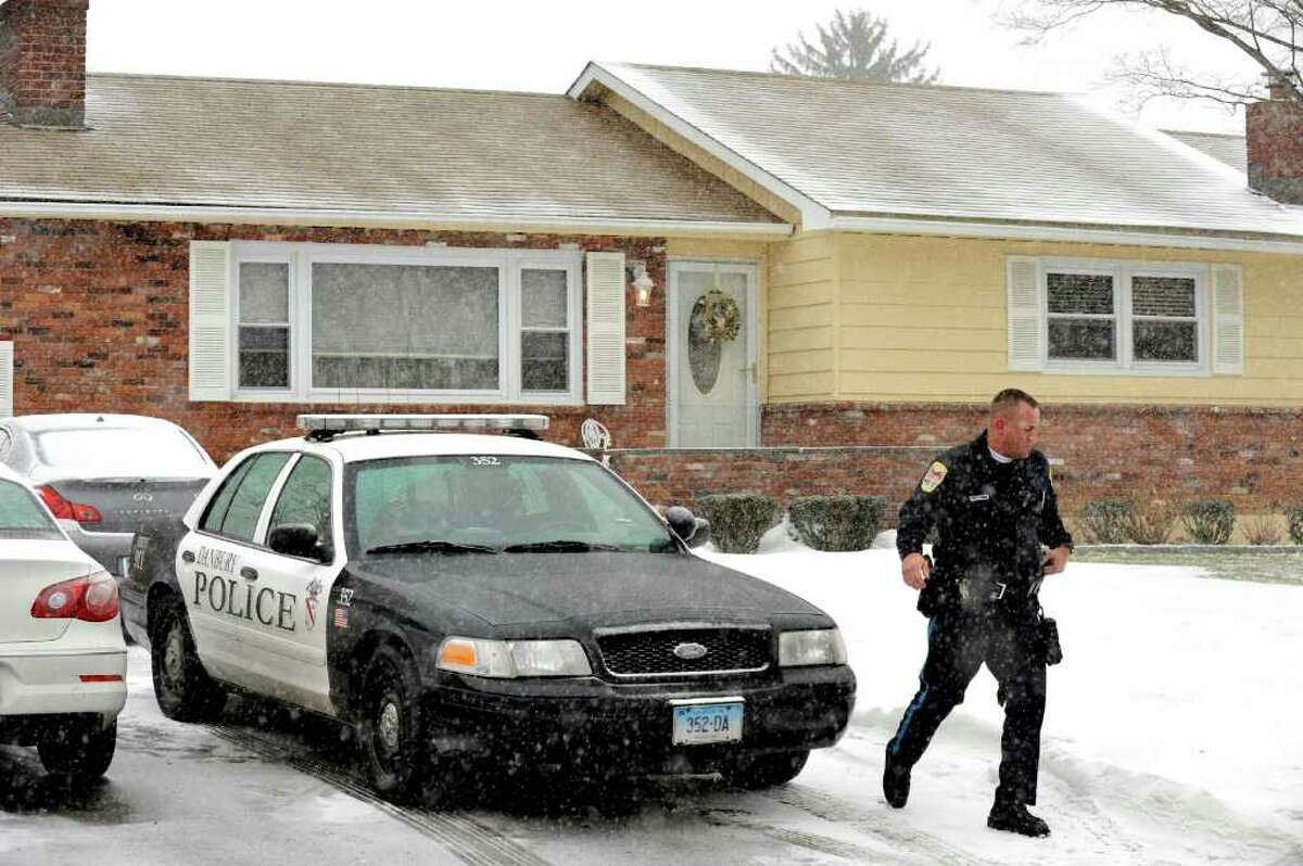 Danbury Police officers work outside the scene of a shooting at 14 Ledgemere Drive in Danbury, Friday, Jan. 7, 2011.