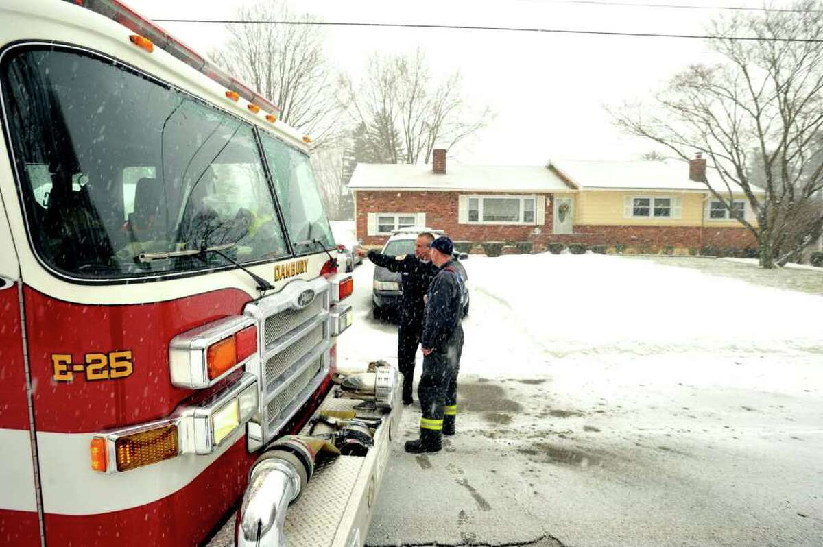Danbury Police and firefighters respond to the scene of a shooting at 14 Ledgemere Drive in Danbury, Friday, Jan. 7, 2011.