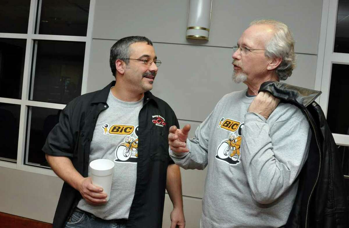 BIC employees Rich Turiano, of Shelton and Rob Rees, of Milford chat during the BIC Flex4 motorcycle unveiling at BIC Corporation in Shelton on Friday, Jan. 7, 2011.