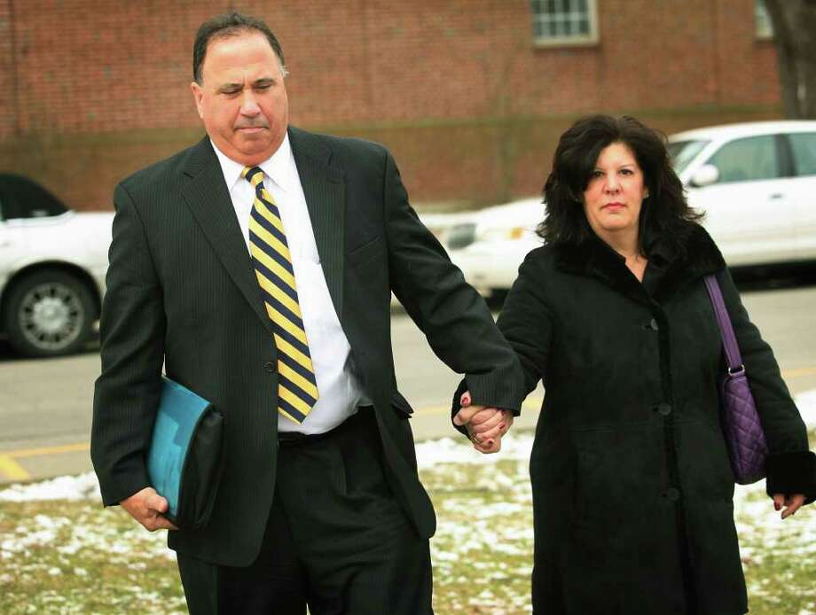 Former Supt. Harvey Polansky leaves Milford Superior Court on Tuesday, February 2, 2010, holding hands with his wife, Harriet Polansky. Photo: Brian A. Pounds / Connecticut Post